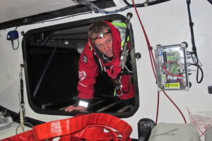 David Swete checks for leaking onboard Team Sanya. Photo / Andres Soriano-Team Sanya
