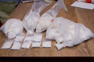 Police seized more than $1million cash, two cars and 5kg of methamphetamine from the pair behind a drug network in Auckland. Photo / Supplied