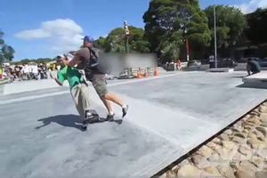 A young skater is pushed over by a man during the Skinny & Serenity National Grom Skate Comp. Photo / Supplied