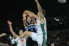Ben Allen of the Crocodiles blocks Tom Abercrombie of the Breakers during game one of the NBL finals series. Photo / Getty Images