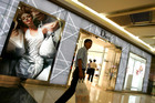 A man walks past a Dior store in Beijing. Photo / AP