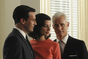 Don Draper's surprising relationship with his secretary, played by Jessica Pare (centre) has upped the competition level between him and Roger Sterling. Photo / Supplied