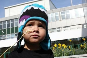 Little Chace Topperwien outside the Royal Marsden Hospital in England.  Photo / Supplied