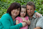 Rachel Jones with her partner David Whitaker and their daughter Mia, 2. Rachel is dying of cancer and wants to raise awareness of sun protection. Photo / Brett Phibbs