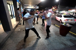 Friends playfight while taking a break from clubbing during Easter weekend on Karangahape Rd. Photo / Bradley Ambrose