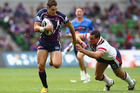 Billy Slater of the Storm runs with the ball during a match between the Melbourne Storm and the Sydney Roosters.  Photo / Getty Images