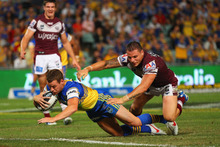 Matt Keating scores for the Eels, who upset the Sea Eagles last night.  Photo / Getty Images 