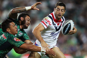 Roosters Anthony Minichiello cuts through the Warriors defence. Photo / Getty Images