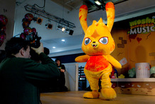 The release of the Moshi Monster's debut album, complete with the store-front performances, brought crowds of children and attendant adults. Photo / AP