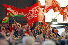 Supporters of Jean Luc Melenchon, leader of France's leftist political party Front de Gauche, and candidate for the 2012 French presidential elections wave flags during an electoral meeting. Photo / AP