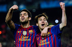 Lionel Messi (right) and Cesc Fabregas were ecstatic to beat AC Milan 3-1.  Photo / AP