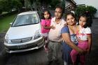 Sneha Dewani with her husband Sree Swami and daughters Diya Swami, 5, and Shriya Swami, 3. Photo / Natalie Slade