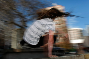 A parkour enthusiast leaps over wall at Aotea Square in central Auckland. Photo / Kenny Rodger