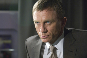 Hard-edged Daniel Craig swaps Bond's vodka martini for the amber fluid in the latest movie. Photo / Supplied