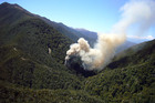 Smoke billows from the ventilation shaft after the fourth explosion in the Pike River coal mine. Photo / NZPA