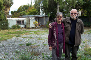 Only a garage is left on the property of Bill and Kathy Lawrence, who say they're suffering a triple whammy paying rates in rent, and rates and insurance on their demolished home. Photo / Simon Baker