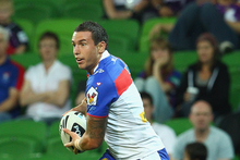 Darius Boyd of the Knights runs with the ball during the round five NRL match. Photo / Getty Images