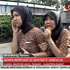Two women react on a street shortly after they ran out from a building in Indonesia. Photo / AP
