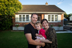 Kayne and Sheree Clifton with Alexis in front of the home they are selling by auction. Photo / Richard Robinson.