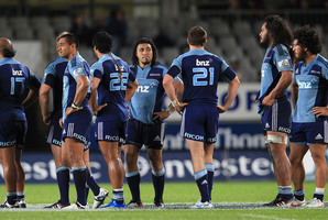 Stunned Blues players after their defeat to the Sharks at Eden Park. Photo / Greg Bowker