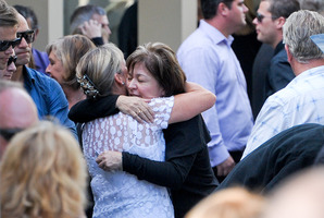 Cyndy McDonald, right, is comforted by a friend at the funeral of her son Cameron in Meadowbank. Photo / Jason Dorday