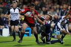 Cory Flynn of the Crusaders is tackled during the match against the Stormers. Photo / Getty Images