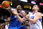 Orlando Magic's Glen Davis (11) and Philadelphia 76ers' Spencer Hawes tussle over a loose ball. Photo / AP