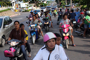 Residents flee on motorcycles to high ground after receiving tsunami warning signals after an earthquake off Indonesia's western coast shook this Thai southern resort province of Phuket. Photo / AP