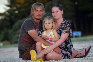 Sara Smith and husband Lance, with daughter Holly. Photo / Richard Robinson