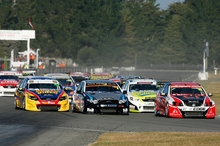 Fabian Coulthard (red car) leads the pack at round two of the V8 SuperTourers at Ruapuna. Photo / Alex Mitchell/Terry Marshall