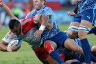 New Zealand's Crusaders Robbie Fruean, left, is tackled by South Africa's Bulls Johann Sadie during their Super Rugby match at the Loftus Versfeld stadium. Photo / AP