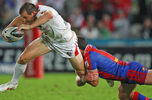 Brett Morris of the Dragon is tackled. Photo / Getty Images 
