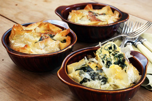 Eggs and silverbeet pie can be made as six individual servings or as one big family sized pie. Photo / Janna Dixon