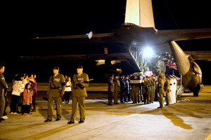 Senior military officials pay tribute to CPL Hughes as he is carried off a RNZAF C-130 aircraft. Photo / Supplied