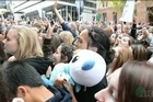 Screaming teenagers packed Sydney's Martin Place as British boy band One Direction stopped traffic in the city.