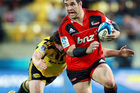 Corey Flynn of the Crusaders is tackled by Richard Buckman of the Hurricanes. Photo / Getty Images