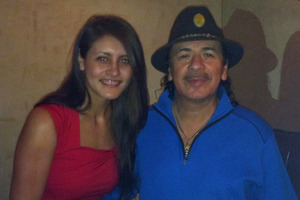 Sarah Johnston with guitarist Carlos Santana who gave the young jazz singer some good advice. Photo / Facebook