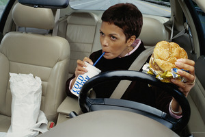 Researchers at the University of Leeds in Britain found reaction times of drivers while eating were up to 44 per cent slower than usual. Photo / Thinkstock