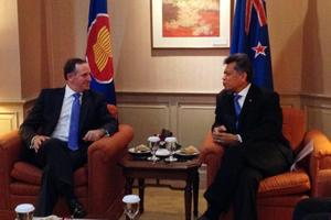 John Key Meeting ASEAN Secretary-General Surin Pitsuwan. Mr Key's relaxed style has been appreciated on this trip to Indonesia. Photo / Twitpic @johnkeypm
