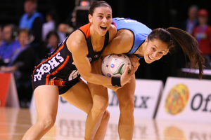 Southern Steel's Courtney Tairi (right) and Tactix's Maree Bowden compete for the ball in the Steel's 55-53 victory yesterday. Photo / SNPA