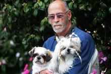 Breeder Paul Henry with two of his dogs, Kisses and Dora.