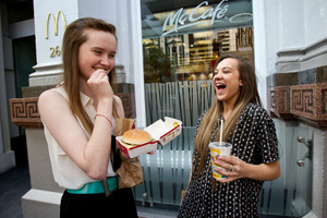 Kate Fitzgibbon, 16, from Grey Lynn (left) and Mily Hemi, 17, from Manurewa look forward to their fast-food meals. Photo / Dean Purcell