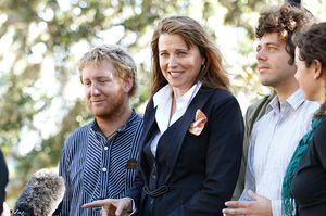 Actress Lucy Lawless, with fellow Greenpeace activists, after an appearance in the New Plymouth District Court. Photo / Mark Mitchell
