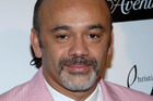 Shoe designer Christian Louboutin says heels are pleasure and pain. Photo / AP