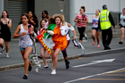 Teenage boy band One Direction proved elusive to about 200 excited fans at Auckland International Airport. Photo / Dean Purcell