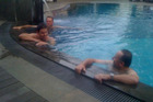 Patrick Gower (left) and John Key in a pool in Indonesia. Photo / Jared Mason