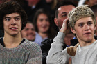 Harry Styles and Niall Horan of One Direction look on from the sideline during the ANZAC Test match between the New Zealand Kiwis and the Australian Kangaroos at Eden Park. Photo / Getty Images