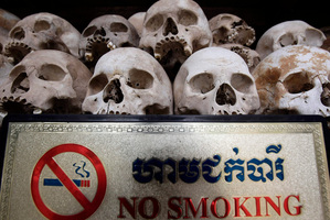 Human sculls are displayed in the stupa of Choeung Ek, a former Khmer Rouge 'killing field' dotted with mass graves about nine miles (15 km) south of Phnom Penh, Cambodia. Photo / AP