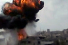 In this image made from amateur video released by the Shaam News Network, smoke billows an impact following purported shelling in Homs, Syria. Photo / AP