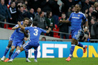 Juan Mata (left) is mobbed by teammates after scoring in Chelsea's FA Cup semifinal win over Spurs yesterday. Photo / AP